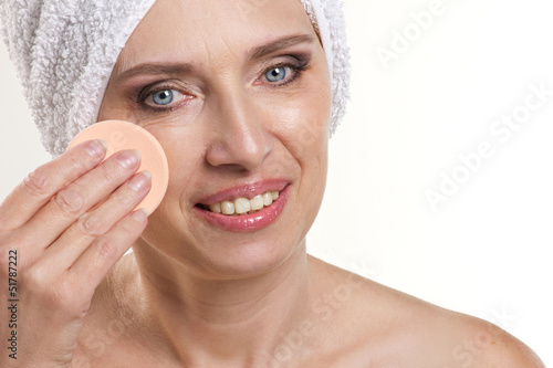 mature woman doing spa procedure