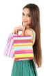 Young beautiful girl in green dress holding bright  shopping