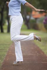 High Heels balancing woman park outdoor
