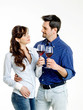 Young couple celebrating with red wine