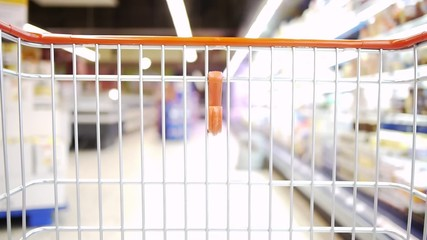 Shopping Cart - moving slowly in the market - orange