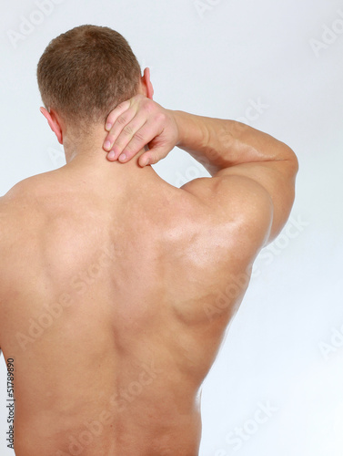 Muscular man with back neck ache