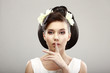 Hush! Woman showing Silence Sign with her Forefinger. Warning