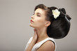 Hairstyle Design. Sensual Woman with Creative Coiffure. Glamor