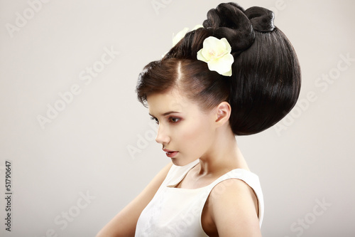 Vogue Style. Classy Woman with Trendy Hairstyle. Allure