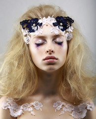 Relax. Styled Blonde with Painted Skin. Dreams. Closed Eyes