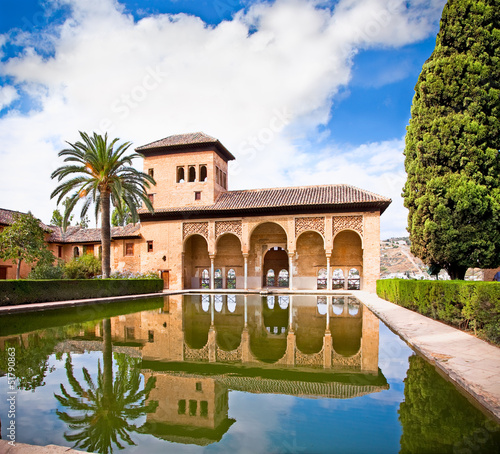 Alhambra palace reflected in water in Granada. Spain.