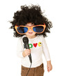 Little girl in afro wig holding a microphone