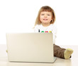 A little girl with a laptop sitting on the floor
