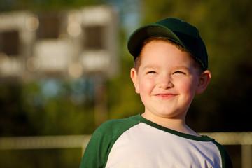 Portrait of child baseball player on field