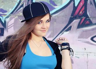 Playful Teenager Girl Posing near Wall