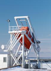 Orange ship's freefall lifeboat