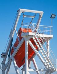 Orange ship's freefall lifeboat on the aft