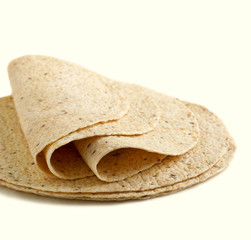 Whole wheat tortillas on a white background