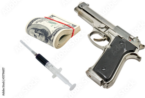 Pistol, money and syringe