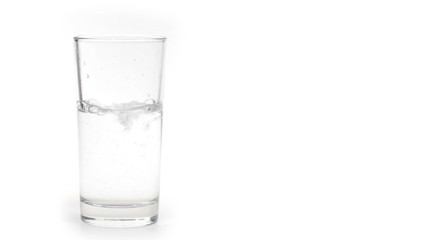 Glass of water with ice isolated on white background.