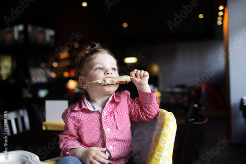 Child biting kebab