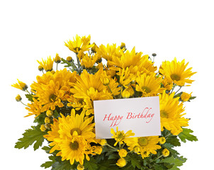 Yellow chrysanthemum with a card