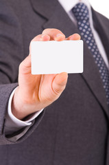 Business man showing blank card.