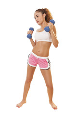 Fit woman holds hand weights like she's boxing.