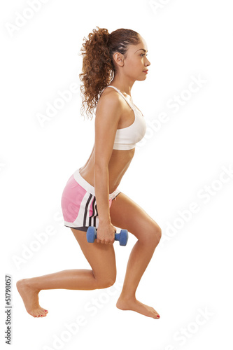 Fit woman does lunges while holding hand weights.