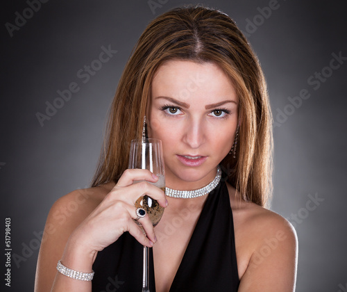 Young Beautiful Woman Drinking Champagne
