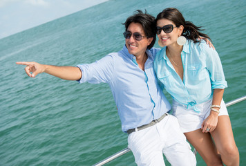 Couple pointing away in a yacht