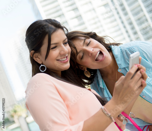 Girls using app on smart phone