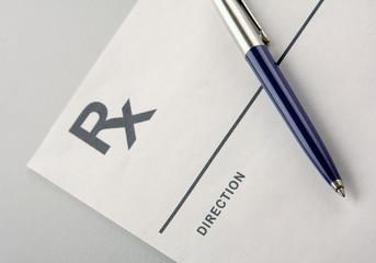 A blue pen on a rx prescription