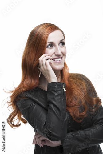 Attractive redhead chatting on her mobile