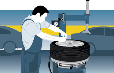 Mechanic repairing tire