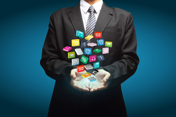Cloud of colorful application icons in the hands of businessmen