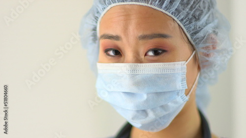Closeup of Chinese doctor wearing mask