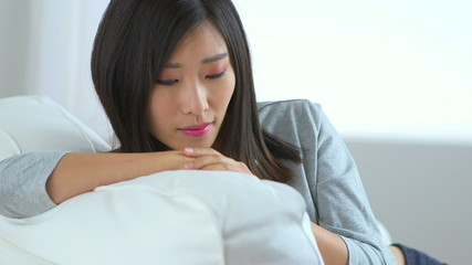 Chinese woman relaxing on couch