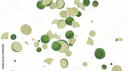 Falling Limes shaping a heart on white background