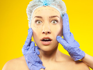 Plastic  surgery.  Isolated on yellow
