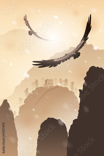Eagles flying over mountains