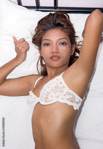 Young beautiful woman resting in bed