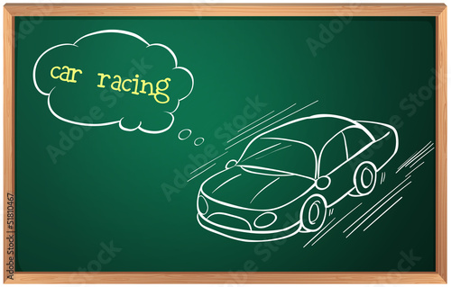 A blackboard with a drawing of a car racing