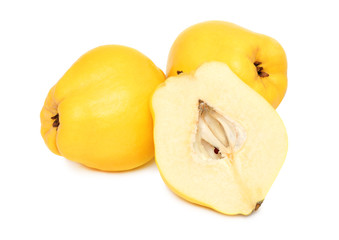 Two whole and a half quince (isolated)
