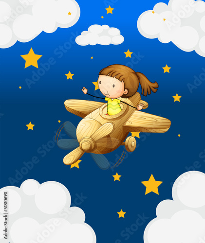 A girl riding in a wooden plane