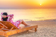 Beautiful woman relaxing at sunrise over Red Sea in Egypt