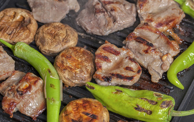 lamb chops with garnish on grill