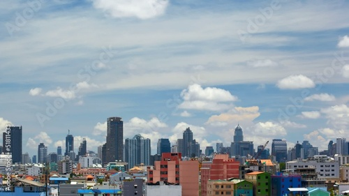Time-lapse cloudy sky over Bangkok skyline