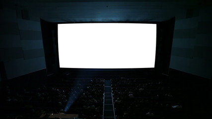 White cinema screen with projector light and audience.