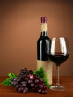 Composition of wine bottle, glass of red wine, grape