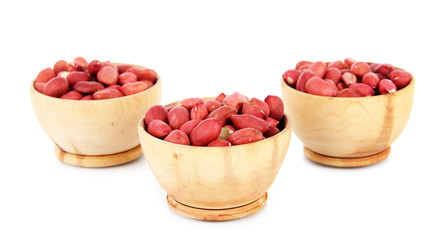 Peanuts in bowls isolated on white