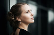 Beautiful woman daydreaming