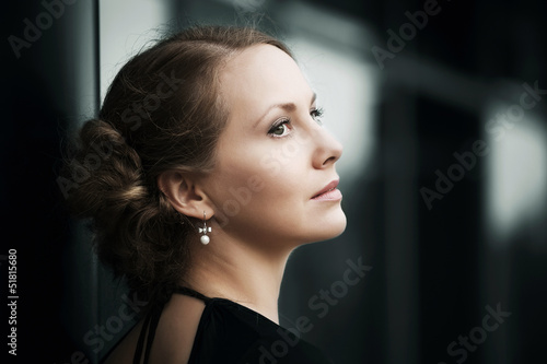 Beautiful woman daydreaming