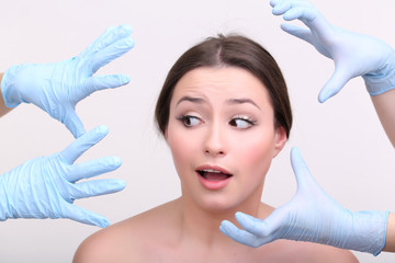 Rubber gloves touching face of young woman close up